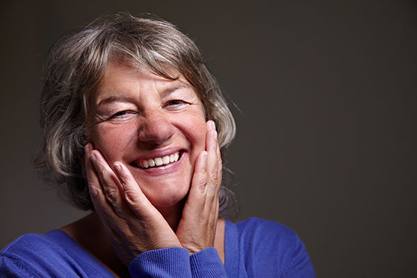 Implant Supported Dentures: Pros And Cons
